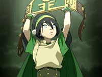 Toph in stereotypical Earth Kingdom green and yellow