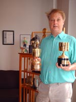 Bill Plympton in front of some of his awards