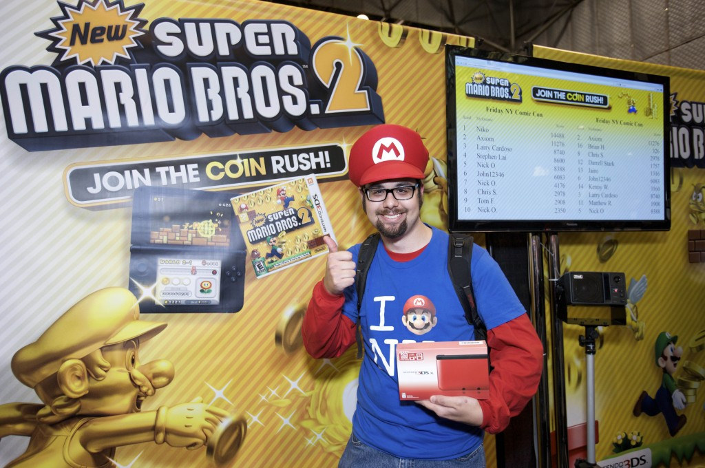 In this photo provided by Nintendo of America, Niko A., 23 years old of West Deptford, NJ receives a Nintendo 3DS XL for winning a New Super Mario Bros. 2 game-play tournament at the Javits Center in New York on Oct. 12, 2012. The Nintendo 3DS XL is a hand-held entertainment device that allows users to play video games, enjoy music videos and trailers, take 3D photos and more. New Super Mario Bros. 2 is one of more than 500 games in the Nintendo 3DS library, which provides an unparalleled list of rich game-play experiences for every age and skill level.