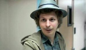 "Michael Cera makes a cameo appearance as ""a friend"" with a hat and an old-school porn mustache in the final scenes of ""Attention Staff""."