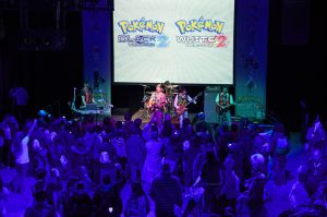 In this photo provided by Nintendo of America, fans gather at SIR Stage37 in New York on Oct. 13, 2012 for the Pokémon Black Version 2 and Pokémon White Version 2 Launch Celebration event, which featured a live performance by rock band I Fight Dragons. The video games are now available for the Nintendo DS family of portable video game systems and are also playable in 2D only on Nintendo 3DS and Nintendo 3DS XL systems.. (Anders Krusberg for Nintendo of America)