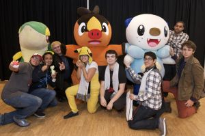 In this photo provided by Nintendo of America, fans interact with Pokémon Snivy, Tepig and Oshawott at a special pre-sale event at Nintendo World on Oct. 6, 2012, in celebration of the launch of Pokémon Black Version 2 and Pokémon White Version 2 on Oct. 7. (Photo: Business Wire)