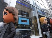 In this photo provided by Nintendo of America, Mii characters congregated in front of Nintendo World in New York on Nov. 16, 2012 to celebrate the upcoming launch of Wii U. Wii U, the newest home console from Nintendo, launches on Nov. 18, 2012 and is set to change the way people interact with their games, their TVs and each other. Photo Credit: Anders Krusberg/AP Images for Nintendo of America