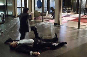 Malcolm Merlyn lies incapacitated after eating a horsemeat slider at the Big Gala - or possibly because he was shot with a curare-tipped bullet by Deadshot.