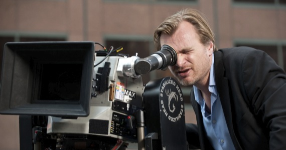 Director Christopher Nolan peers through a camera while pondering which family member he will employ next on his upcoming film, 'Interstellar'.