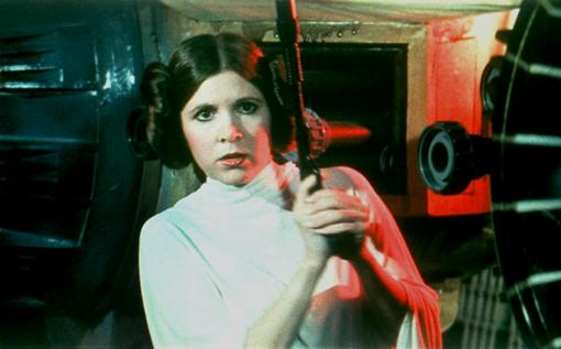 "Carrie Fisher prepares to kick some Stormtrooper ass as Princess Leia in the original ""Star Wars""."