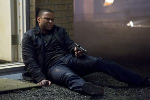Diggle sits out Round Three of the Celebrity Archer DeathMatch between Arrow and Dark Archer in the season finale.