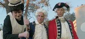 """Sy and the base commander [Steven Weber from """"Wings""""] enjoy watchign teh Chief churn butter on Old Fashioned Day."""