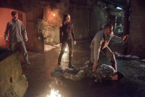 Deadshot, Lyla and Diggle make their escape from the Russian gulag prison.