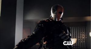 Slade in his DeathStroke-like mask threatening Seb Blood.