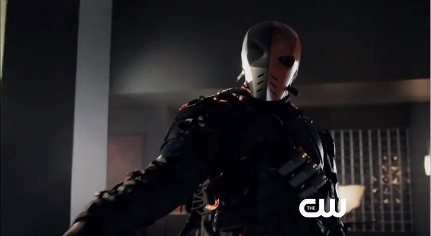 Slade in his DeathStroke-like mask threatening Seb Blood.