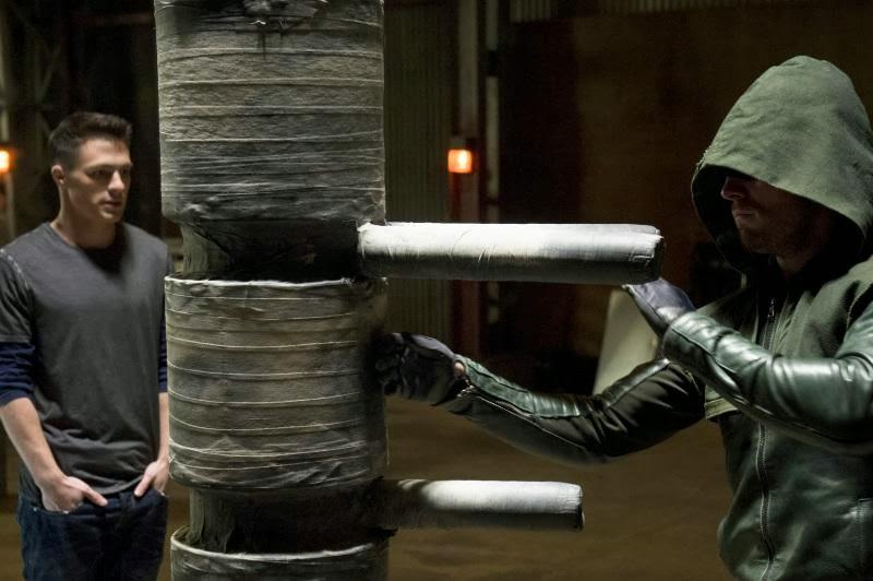 Arrow gives Roy a little hand-to-hand combat technique lesson.