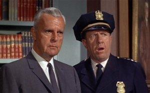 The original Commissioner Gordon [with an astonished Chief O'Hara]