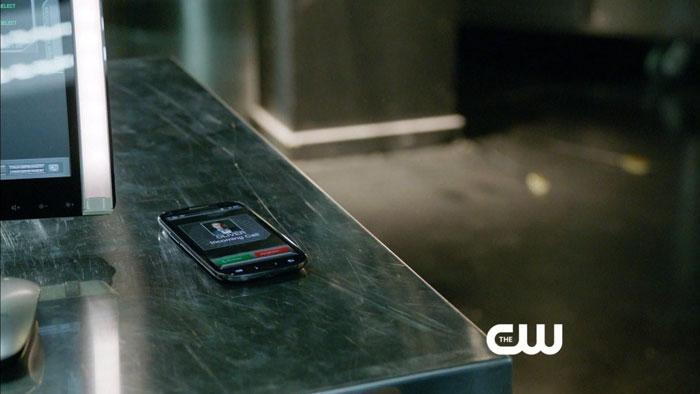 Oliver's cell phone alerts the Arrow Lair to spring into action in an attempt to rescue him from Slade at the Queen Mansion.