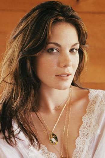 """""""Pixels"""" military weapons expert, Michelle Monaghan."""