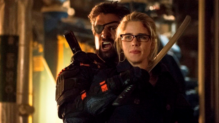 Confident Felicity about to poke Slade with the mirakuru cure after he stops yelling in her ear.