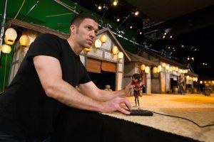 Director and animator Travis Knight working with Kubo on the Sun Village set for animation studio LAIKA's epic action-adventure KUBO AND THE TWO STRINGS, a Focus Features release. Credit: Steve Wong Jr Laika Studios/Universal Pictures